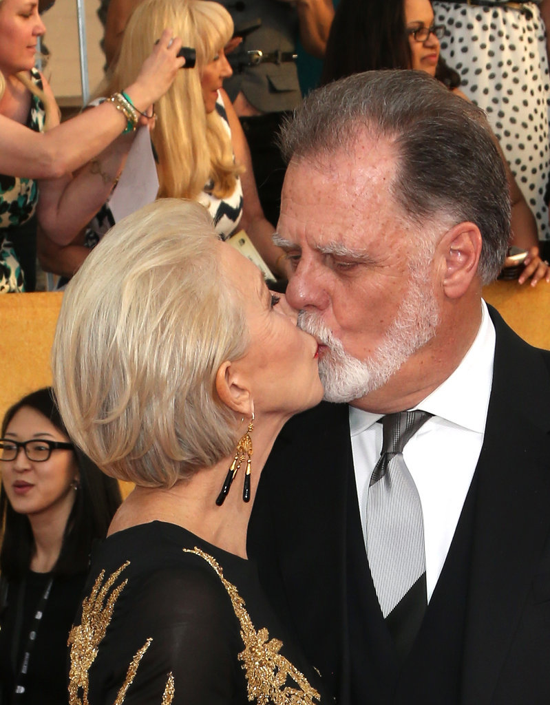 Helen Mirren gave her husband, Taylor Hackford, a kiss while walking the red carpet.