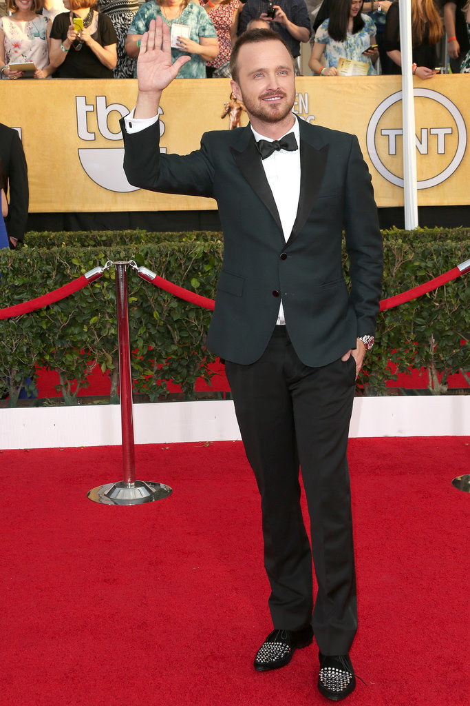 Aaron Paul waved to fans as he hit the red carpet.