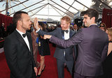 Aaron Paul got attention from Jesse Tyler Ferguson and his husband, Justin Mikita.