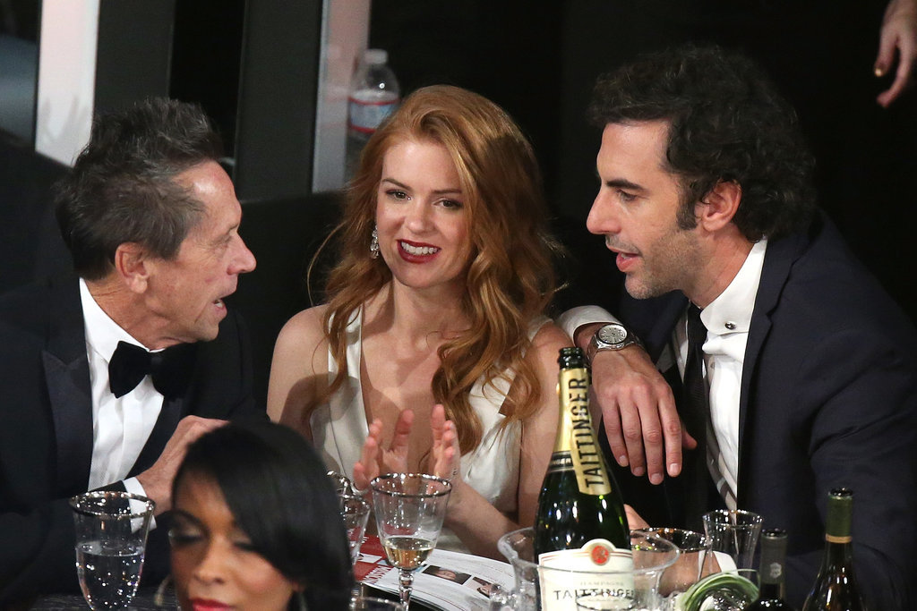 Isla Fisher and Sacha Baron Cohen kept close in the crowd.