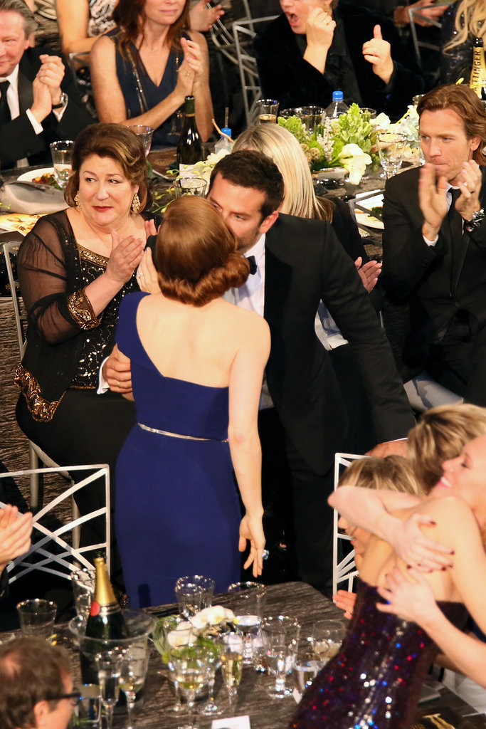 Bradley Cooper kissed Amy Adams in the crowd.
