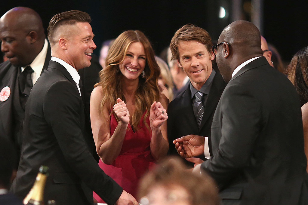 Brad Pitt cracked up with Julia Roberts, Danny Moder, and Steve McQueen.