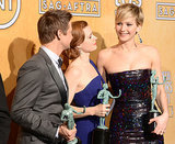 Jeremy Renner, Amy Adams, and Jennifer Lawrence smiled after their ensemble win for American Hustle.