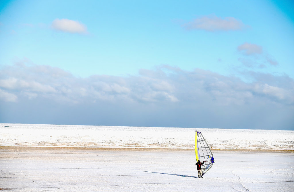 In Chicago, a man used a sail to ski along Montrose Beach on the shore of Lake Michigan.