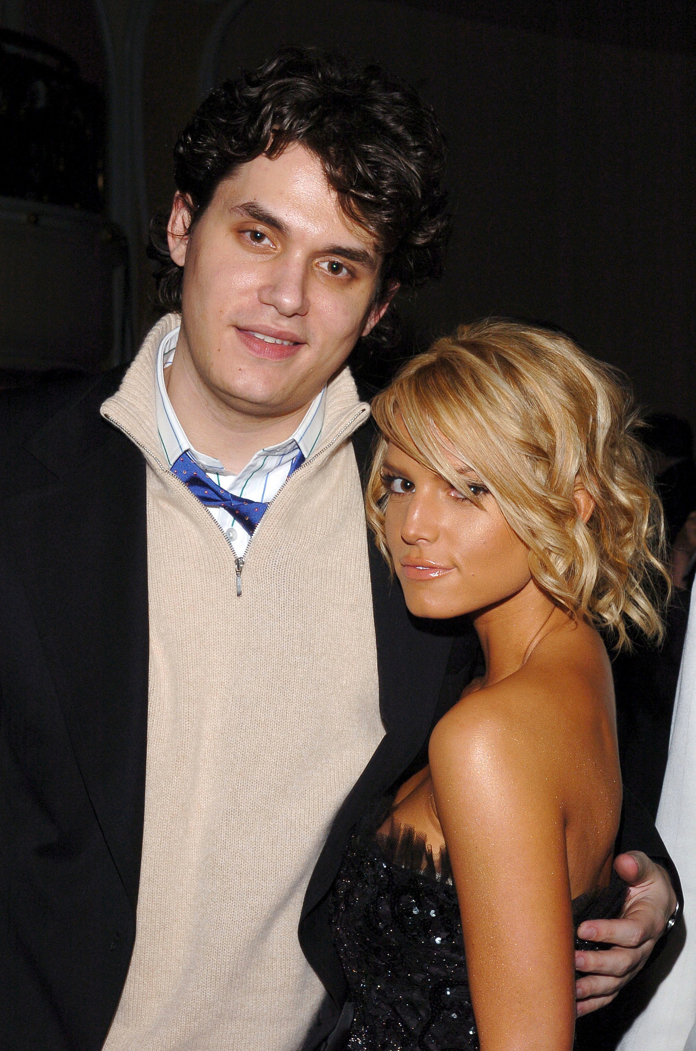 John Mayer posed with a very tan Jessica Simpson in 2005. One year later, they started dating.