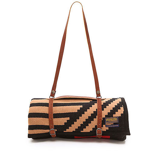 Fitting for picnics, this blanket and strap combo ($298) can easily be taken on the go.