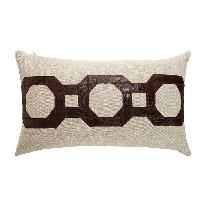 Leather meets luxe in this detailed throw pillow ($250).
