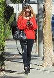 Brightening her black basics with a chunky cardinal-red sweater, Lauren Conrad was the epitome of California cool in October 2013. Where to Wear: An amusement park.