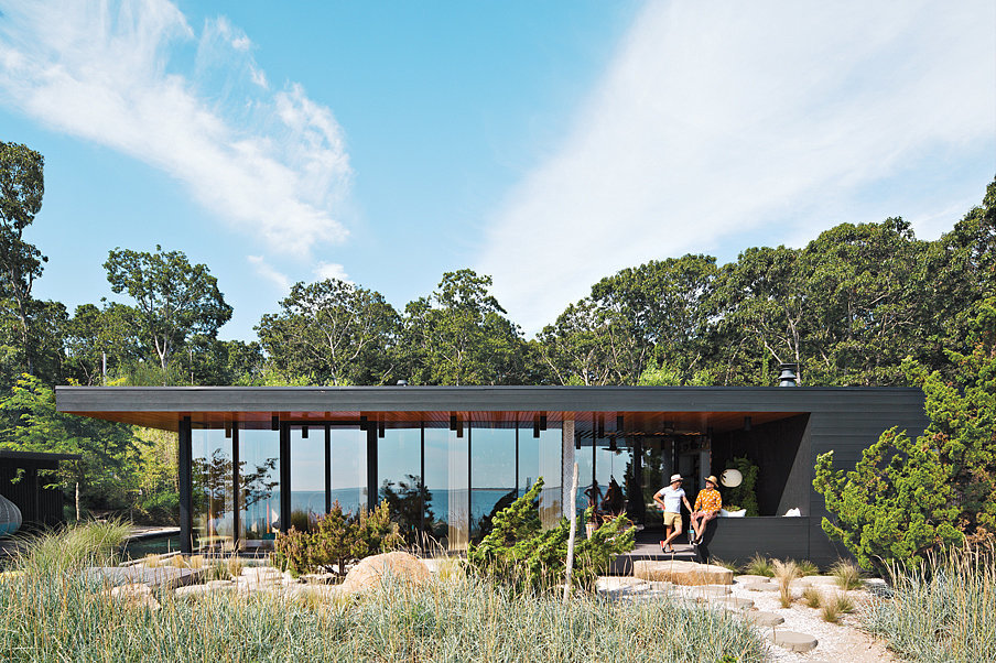 From the outside alone, you can tell the home is warm, rustic, and modern. Surprisingly, the couple's first ground-up project, they partnered with the design firm Gray Organschi to create this 2,800-square-foot midcentury-inspired vacation home. Photo by Floto + Warner via Dwell Magazine
