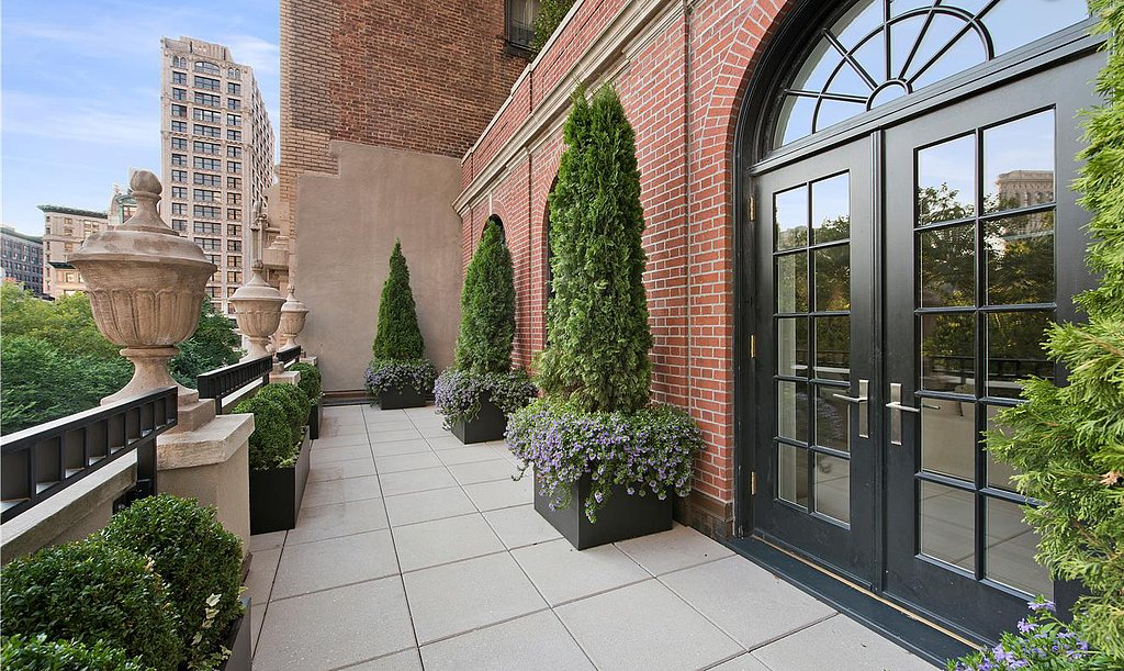 Beautiful potted plants add to the terrace's posh ambiance. Source: Douglas Elliman Real Estate