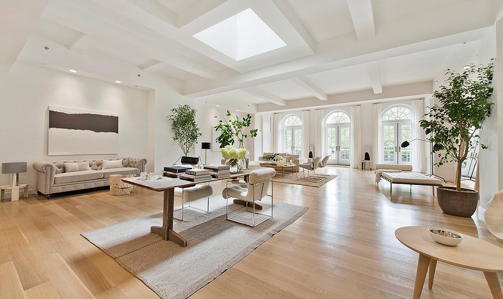The open floor plan feels bigger and brighter with vaulted ceilings, skylights, and floor-to-ceiling windows. Source: Douglas Elliman Real Estate