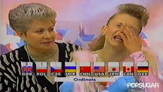 Are those happy tears? We have to assume yes — Oksana had just found out she won the gold.