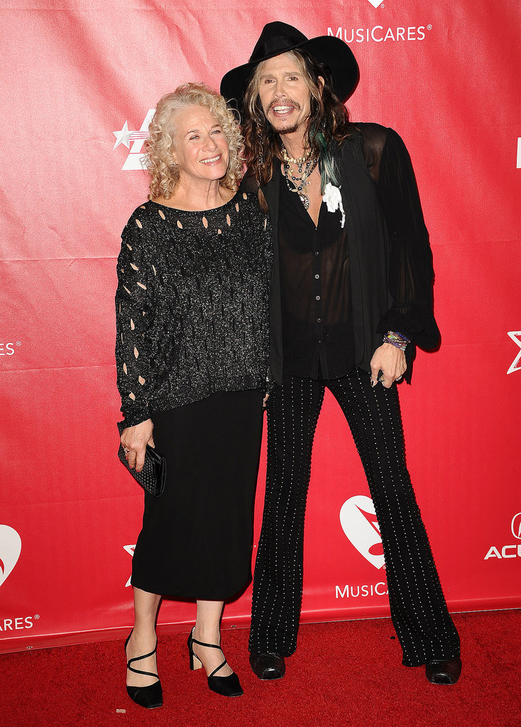The night's honoree, Carole King, linked up with Steven Tyler on the red carpet at the 2014 MusiCares Person of the Year event.