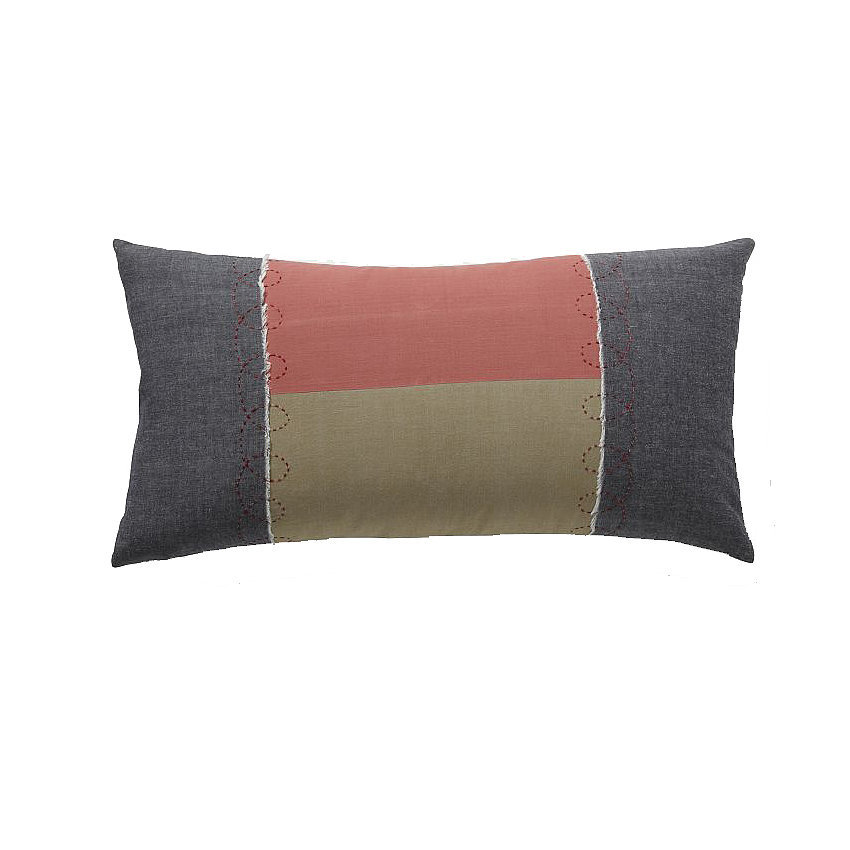 Use a quilted pillow ($17, originally $29) to give seating a funky look and feel.