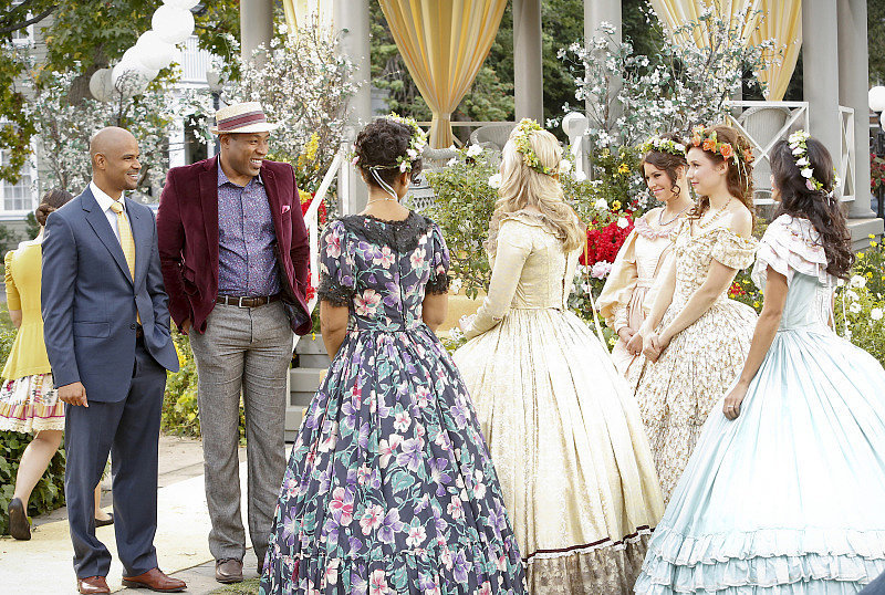 The belles look absolutely lovely in their full-skirt dresses while chatting with Mayor Hayes.