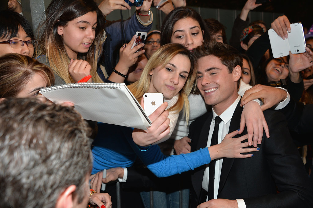 On Monday, Zac Efron took photos with a large group of female fans at the LA premiere of That Awkward Moment.
