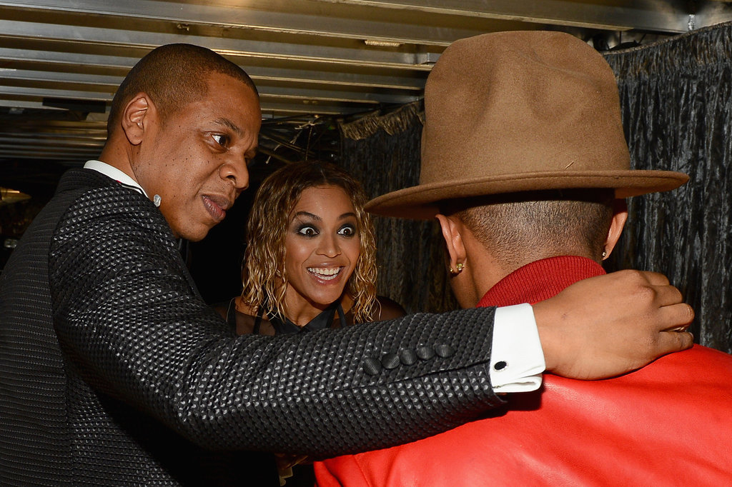 Beyoncé looked excited to see Pharrell's hat at the Grammys.