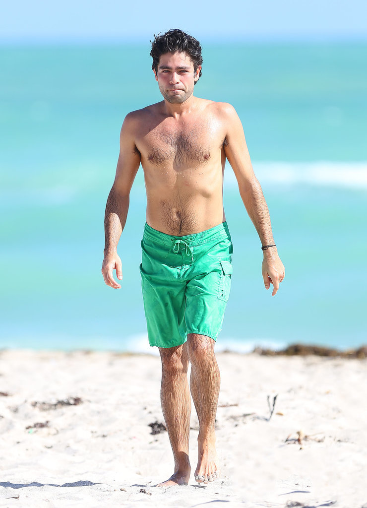 Adrian Grenier wore green boardies at Miami Beach in December 2013.
