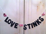 No anti-Valentine's Day get-together is complete without a love stinks banner ($25).