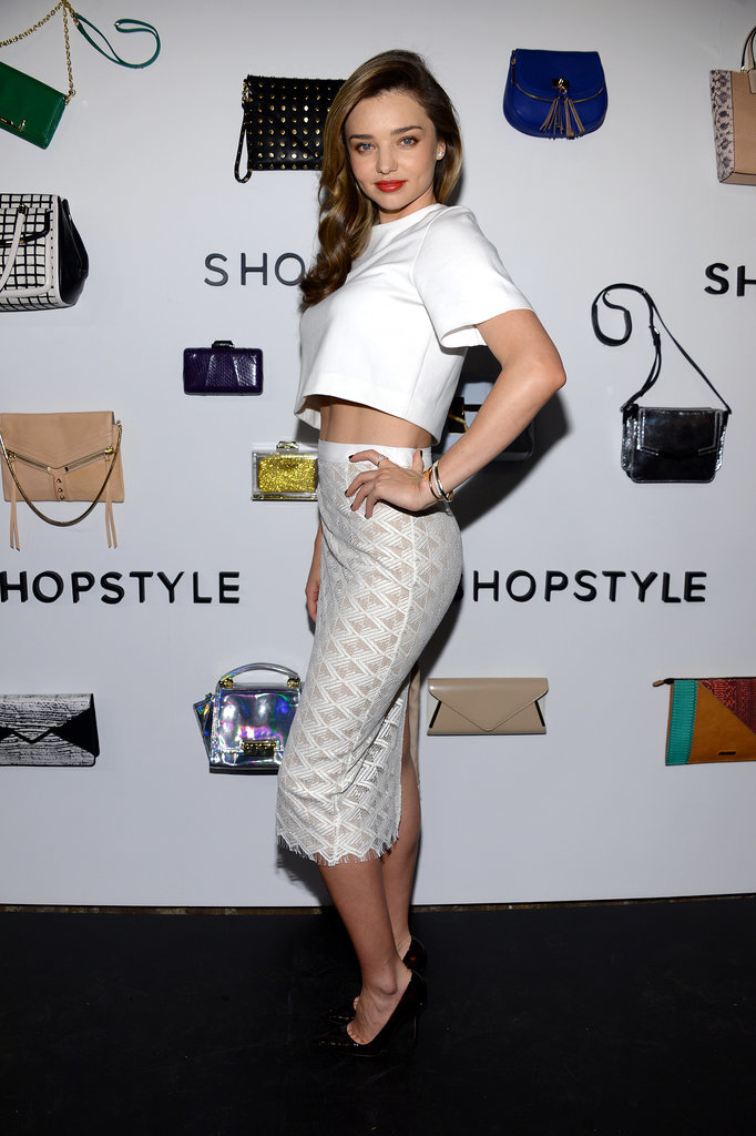 Miranda Kerr braved the chilly weather on Monday in a white crop top and skirt at our NYC party to celebrate her partnership with ShopStyle.