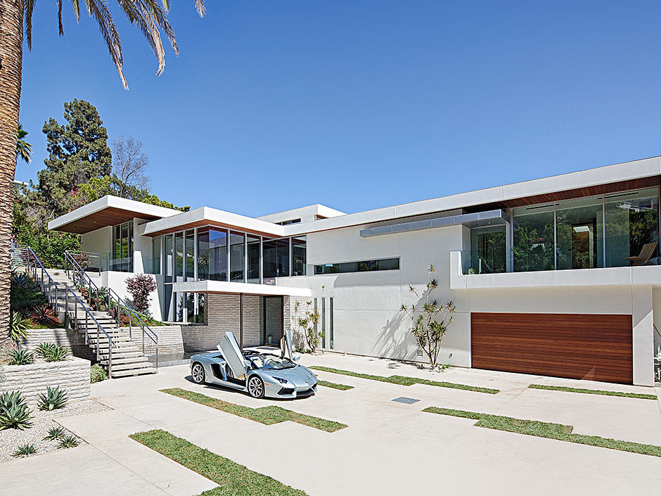 The property's drive-in entrance is large enough to serve as an open garage.  Source: The Agency