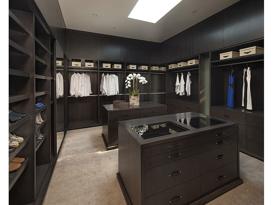 This walk-in closet has everything you could ask for. Source: The Agency