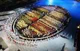 Meanwhile, the athletes were lined up in a perfect, colorful oval.