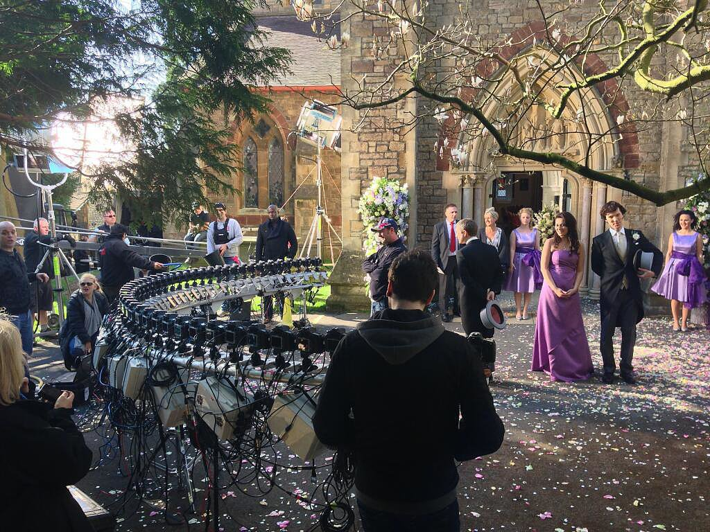"""What do you mean you didn't press the shutter!"" From Steve Lawes, director of photography on the second episode, ""The Sign of Three,"" with a totally different perspective on the flashing cameras when Watson and Mary emerge from the church on their wedding day.  Source: Twitter user SteveLawes"
