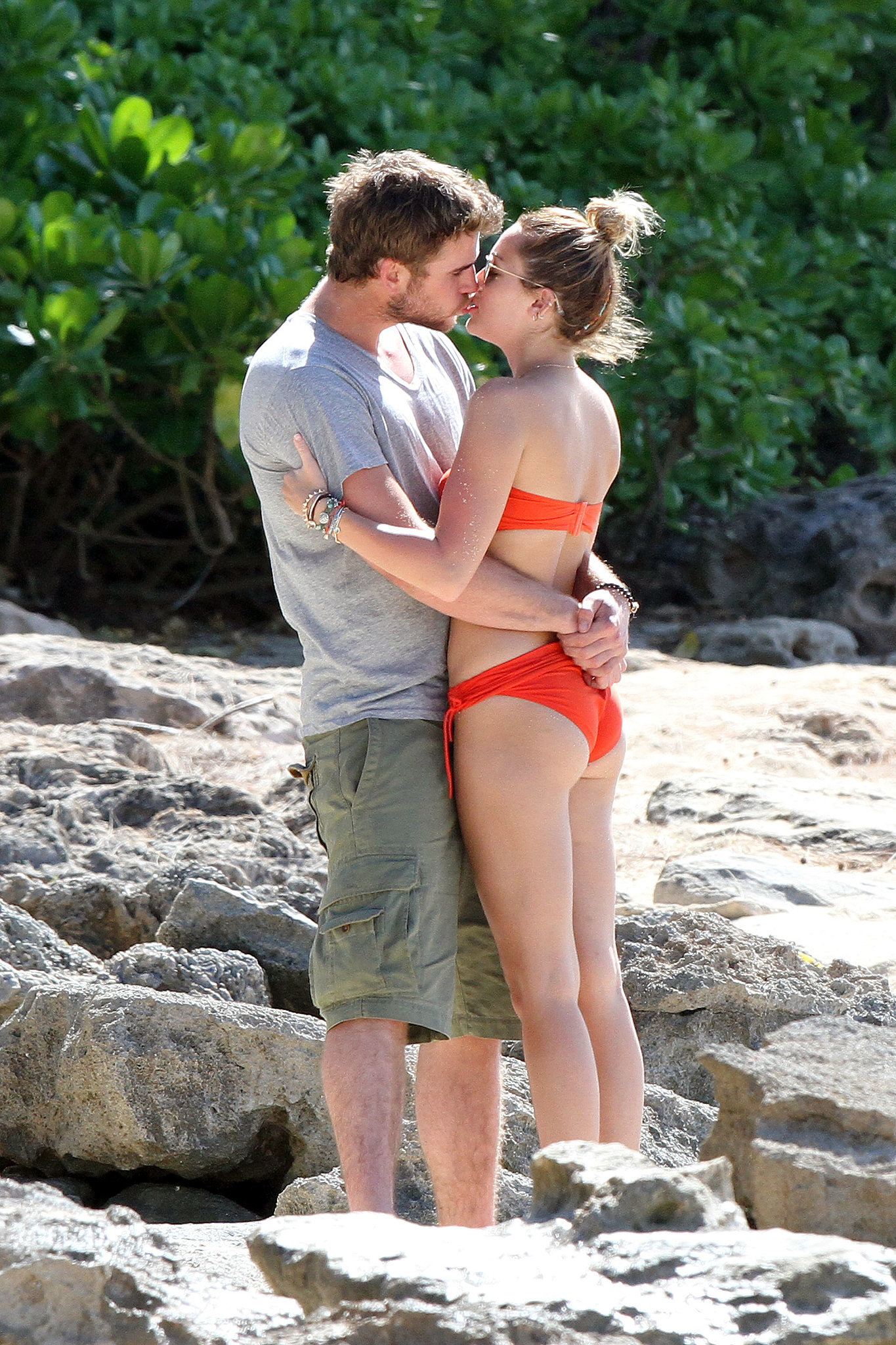 Miley Cyrus and Liam Hemsworth kissed on the beach in Hawaii in December 2011.