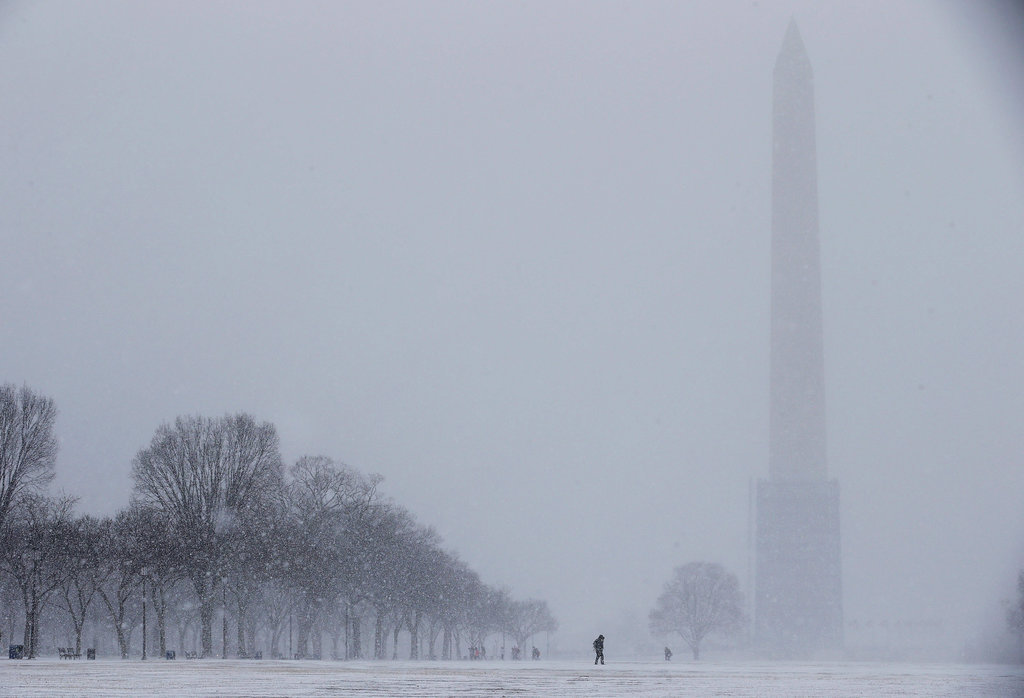 The Washington Monument was barely visible with snow blowing through Washington DC.