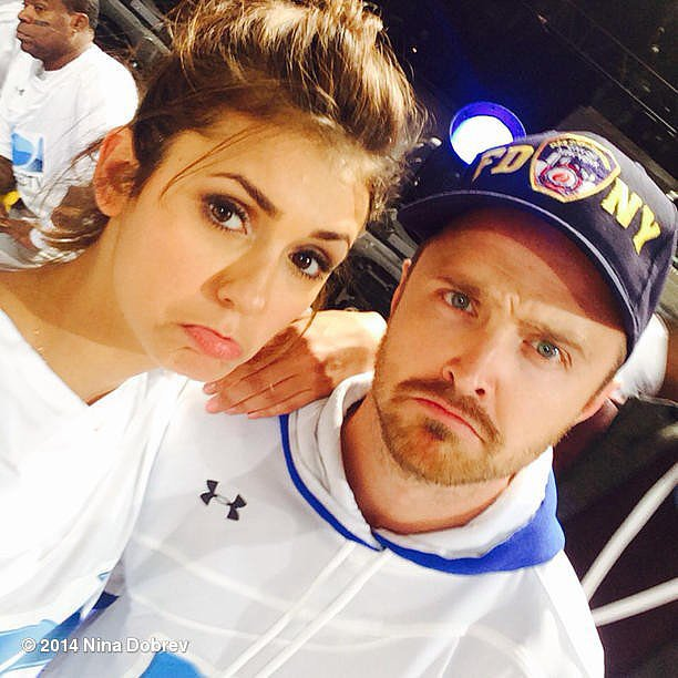 "Nina Dobrev and Aaron Paul were both bummed the Denver Broncos lost at the Super Bowl. ""We lost the game- but hey, 2nd Place is the 1st loser! @glassofwhiskey #beachbowl @direcTV"" Source: Instagram user ninadobrev"