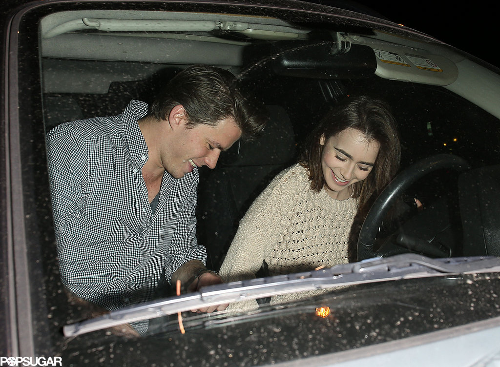 Lily Collins arrived with her rumored new boyfriend, Thomas Cocquerel.