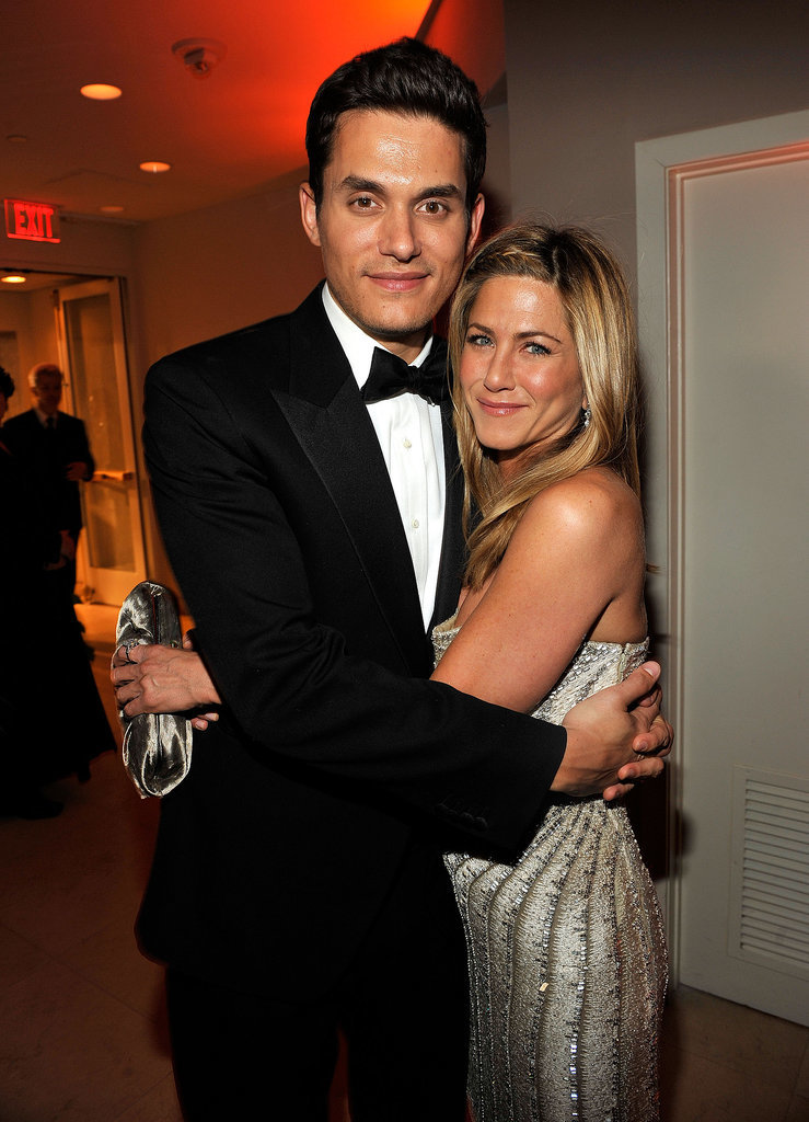She and then-boyfriend John Mayer stayed close at the Vanity Fair Oscars afterparty in February 2009.