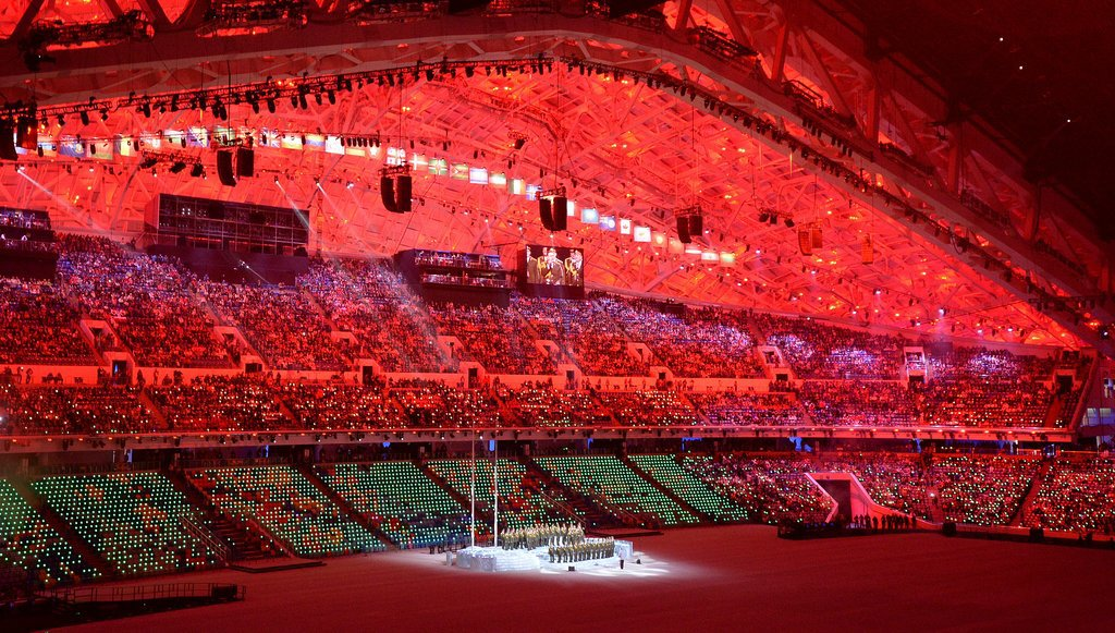 A red glow filled the stadium during the opening ceremony.