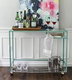 Bar carts can cost you big bucks, unless you hack it. Using an Ikea laptop table and an acrylic sheet, this bar cart tutorial made a very standard piece perfect for entertaining.  Source: Style Me Pretty
