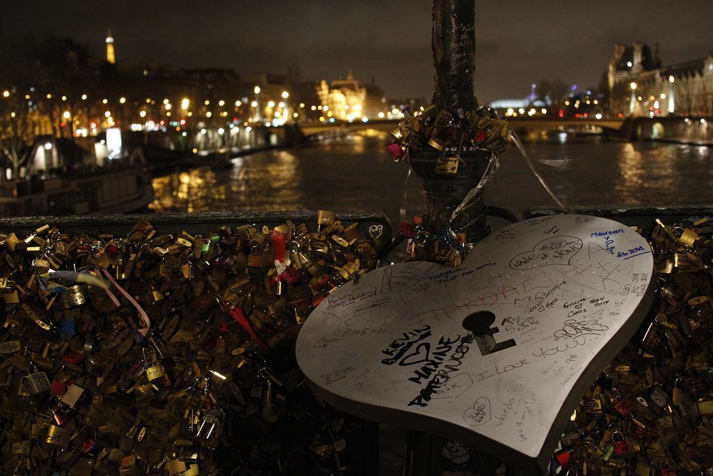 A huge love padlock makes a statement on the Le Pont Des Arts bridge in Paris.