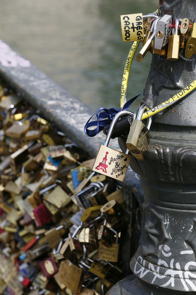 Love padlocks cover the Le Pont Des Arts bridge in Paris.
