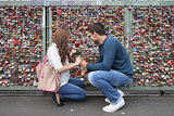 A couple attaches their love lock to the Hohenzollern Bridge in Cologne, Germany.