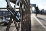 A love padlock is attached to NYC's Brooklyn Bridge.
