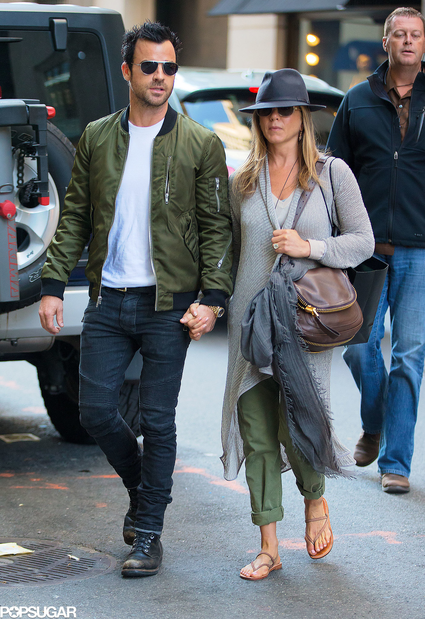 The couple held hands during a day of shopping in NYC in May 2013.