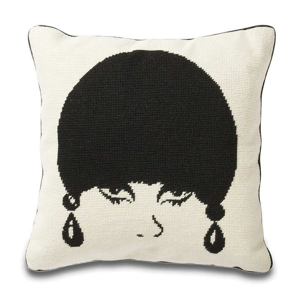 Make an impact with this needlepoint throw pillow ($165) featuring a striking image of a model from the mod era.
