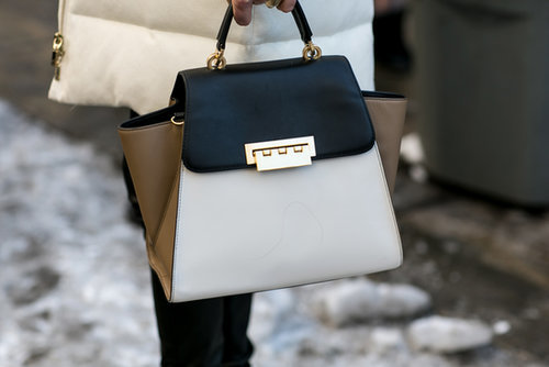 Jessica Hart toted a colorblock Zac Posen bag.