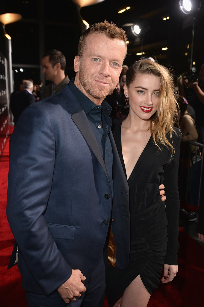 Amber hung out with director McG on the red carpet.