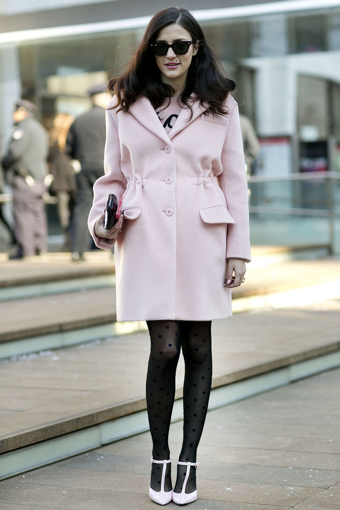 The polka-dot tights, t-strap heels, and petal-pink coat all added up to a retro-inspired style.  Source: Tim Regas