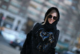 Chiara Ferragni accessorized with black shades and a cozy hood.