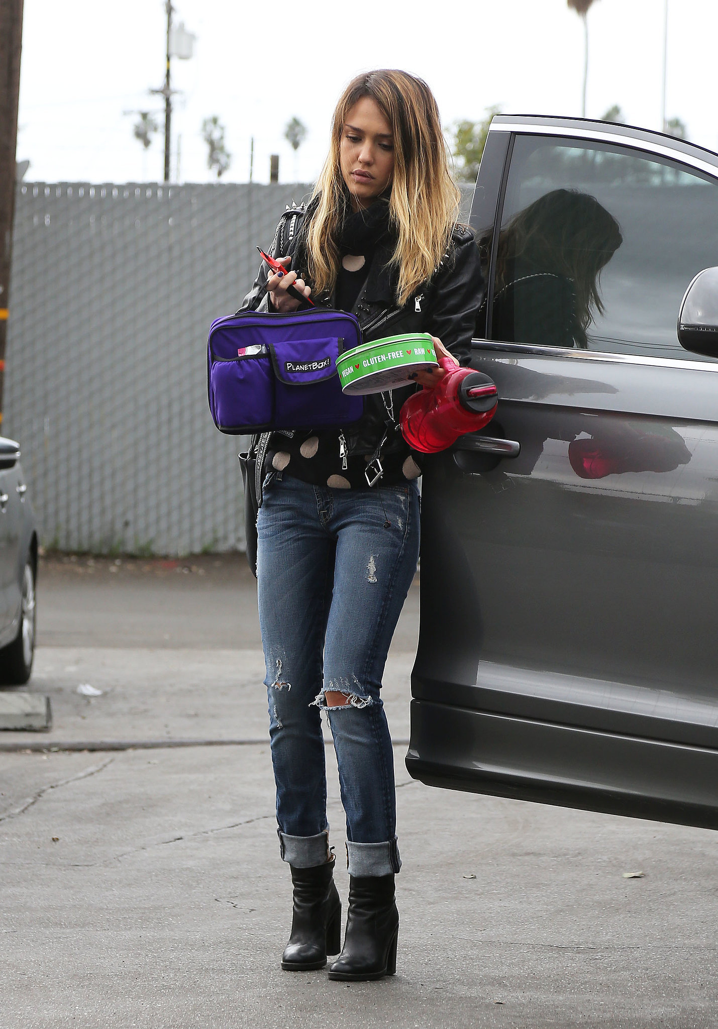 The actress edged up her feminine polka-dot sweater with distressed denim and a black leather Simone jacket in LA.
