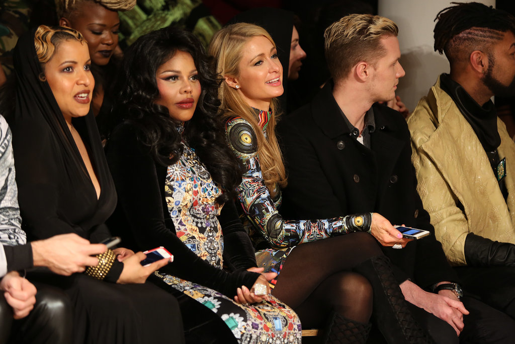 A pregnant Lil' Kim sat next to Paris Hilton at The Blonds fashion show on Wednesday.