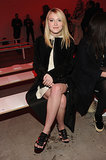 Dakota Fanning opted for a mature look at the Proenza Schouler show on Wednesday.