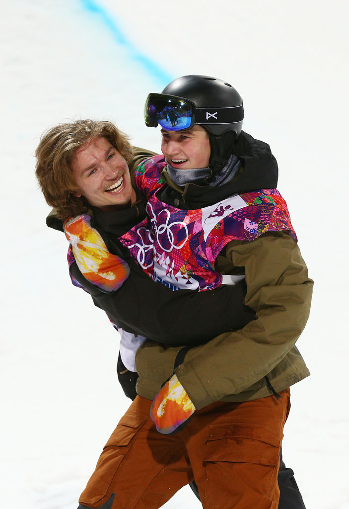 Switzerland's Iouri Podladtchikov and David Habluetzel hugged after competing in the snowboard men's half-pipe finals.