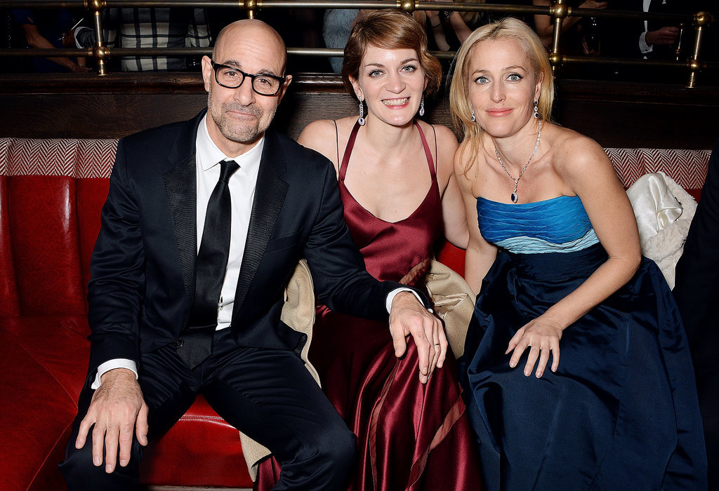 Stanley Tucci held onto Felicity Blunt's knee while they chatted with Gillian Anderson.